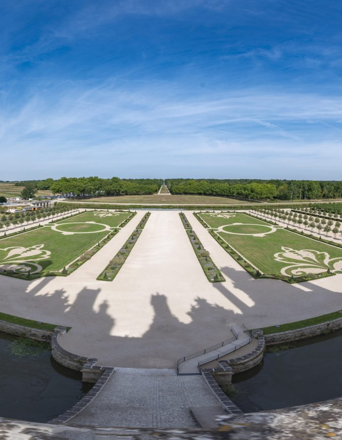 Panoramic from a balcony of the castle of Chambord where you can see its well-kept gardens and the surrounding water pit.